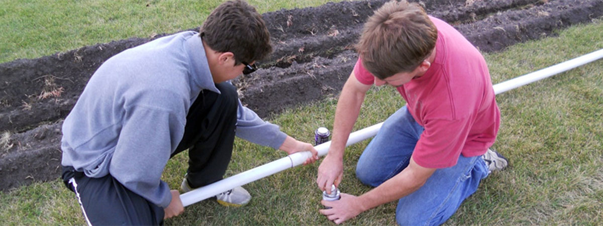 Students putting pipes together
