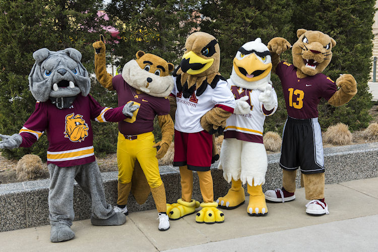 The five U of M campus mascots: Champ, Goldy, Regal, the Raptor, and Pounce