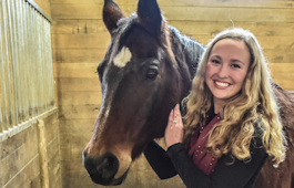 Alum Amberly Cox with a horse