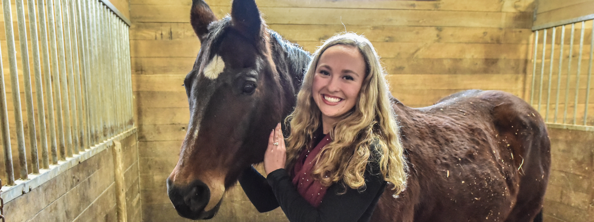 Amberly (Pesall) Cox with a UMC Horse
