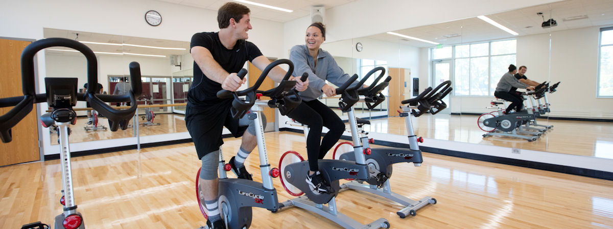 students on exercise cycles