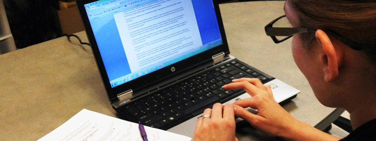 Image of a student typing a paper